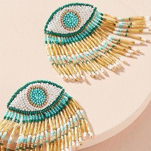 Anthropologie tasseled eye drop earrings